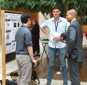 Randy talking with conference guests about research!